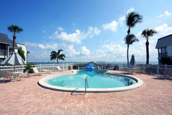 One of the two community pools at Mariner Pointe overlooks San Carlos Bay