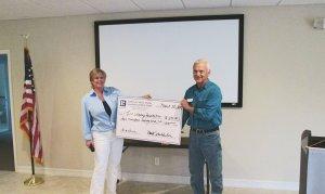 Realtor & Assoc Board Member, Lori Pierot making presentation to Jim Griffith for the International Osprey Foundation.